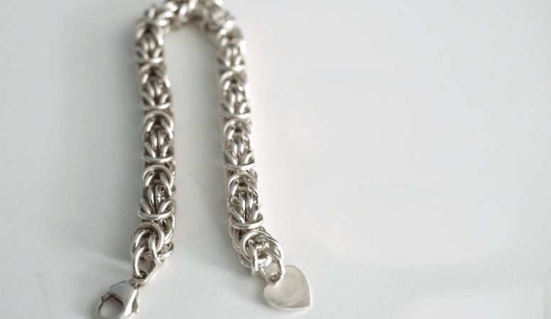 silver bracelet that is partially tarnished