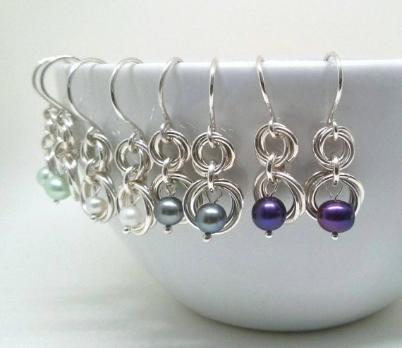 pearl earrings on a mug