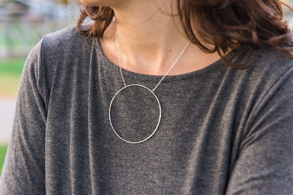 Sterling silver necklace with large hammered hoop