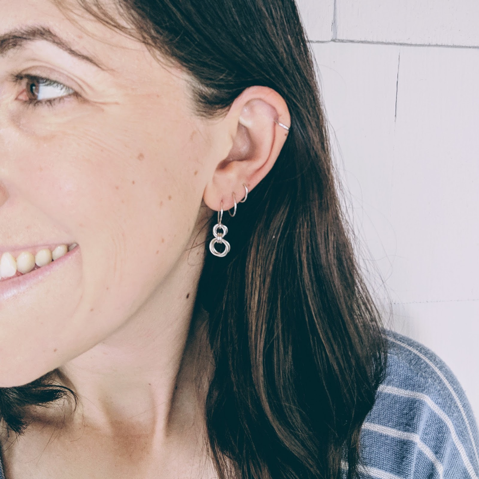 Woman wearing sterling silver earrings