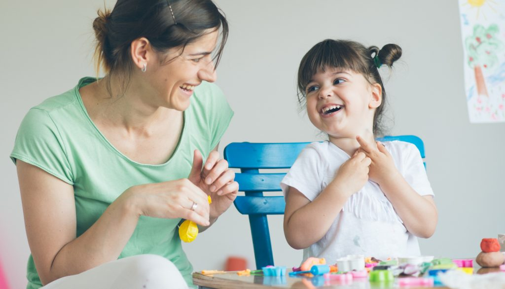 mom and daughter having fun together making art
