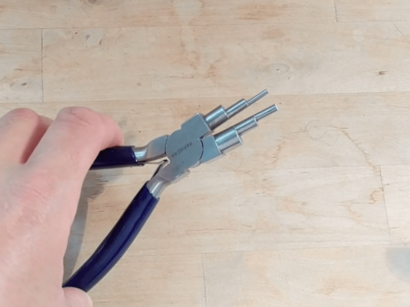 hand holding step pliers