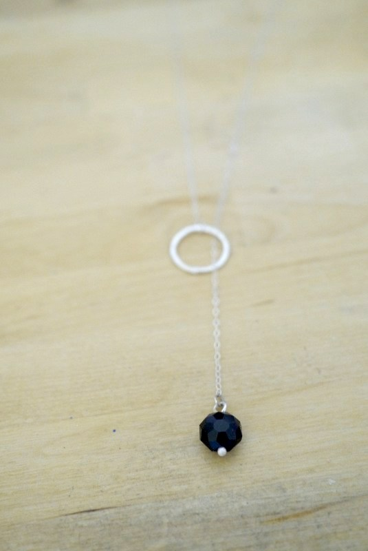 ends of a sterling silver and bead chain lariat necklace